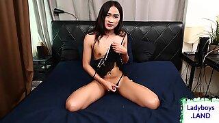 Lingerie ladyboy gently tugging her dick