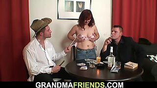 Redhead granny in stockings double fucked on the table