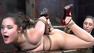 Dungeon lezdom scene with toy fucking of a bound girl