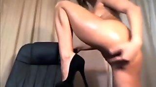 Oiled brunette naked dance