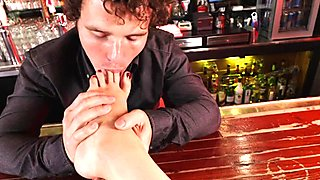 Babe loves footfetish in the bar