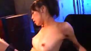 Asian Girl In Sexy Lingery Getting Her Pussy Fucked With Strapon On The Bed In The Basement