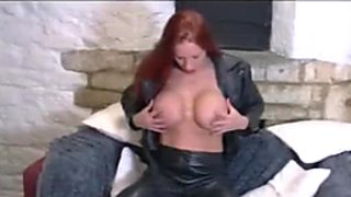 Busty biker babe gets wet and sticky in sexy leather gear