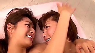 Kinky Japanese lesbian Sakura fucks her girlfriend with a strap-on