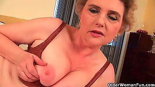 Grandma with large breasts and unshaven pussy
